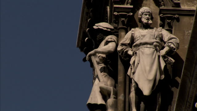 Ornate stonework and statues decorate the facade of the Vienna Rathaus. Available in HD.