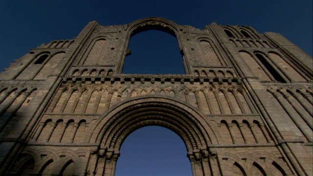 vidéos et rushes de ornate stonework covers the facade of the ruined castle acre priory. available in hd. - stone object