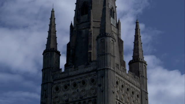 Ornate stonework decorates the spire of Norwich Cathedral. Available in HD.