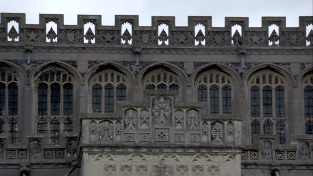 ornate stonework of an exterior wall of the church of st. peter and st. paul. available in hd. - lavenham stock-videos und b-roll-filmmaterial
