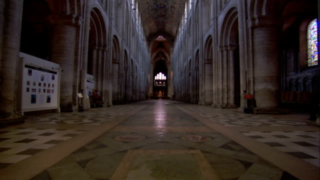 Ornate tile work covers the floor of the nave in the Ely Cathedral. Available in HD.