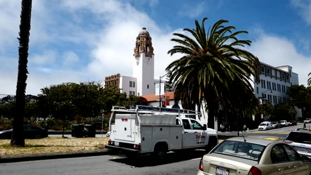 ornate tower of mission high school and dolores street are visible in the mission district of san francisco, california, 2019. - smith tower stock videos & royalty-free footage