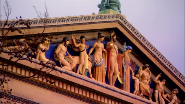 ornate 'western civilization' pediment depicting greek gods & goddesses on facade of philadelphia museum of art. c. paul jennewein, parthenon on... - pediment stock videos & royalty-free footage