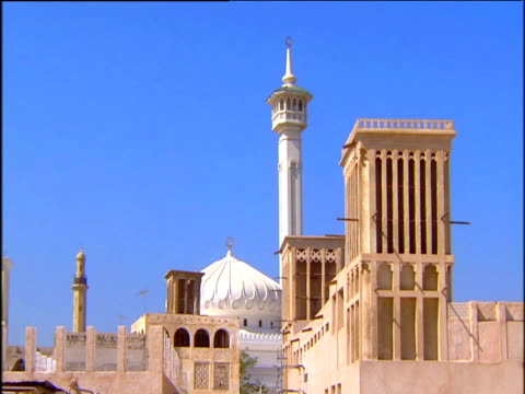 ornate wind towers and minarets under blue sky - tower stock videos & royalty-free footage