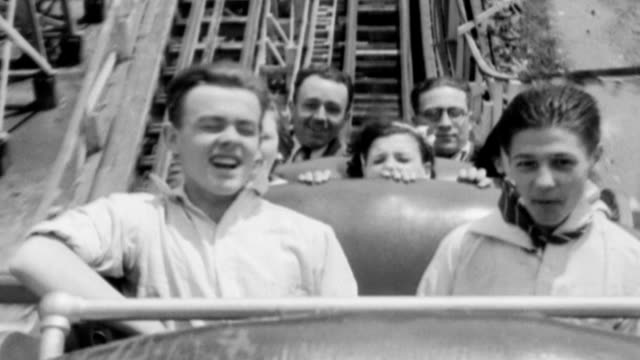 orphan children riding roller coaster during 'orphan day' / onboard view of roller coaster ride orphans ride coney island roller coaster on june 02... - 1932 stock videos and b-roll footage