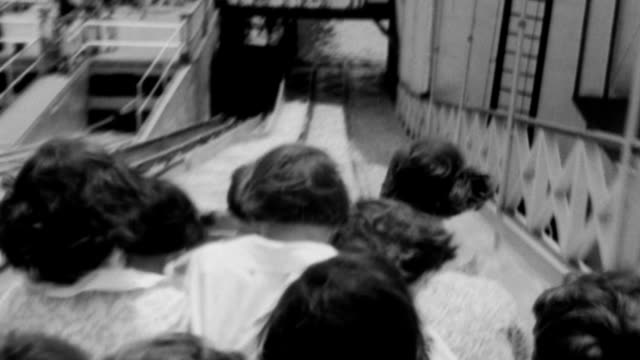 orphan children riding toboggan water slide ride during 'orphan day' / toboggan sliding down chute into water toboggan ride at coney island on june... - 1932 stock videos and b-roll footage