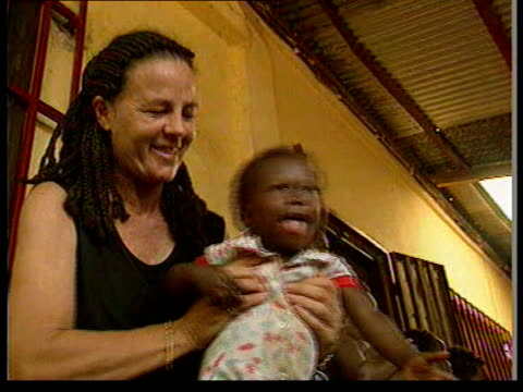 orphans in guinea guinea conakry pinky mccannwillis along with orphans she has rescued from fighting in sierra leone pull out cmss small orphan... - orphan stock videos and b-roll footage