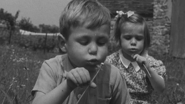 1950 montage orphans jumping rope, blowing thistles, and blowing bubbles / united kingdom - orphan stock videos and b-roll footage