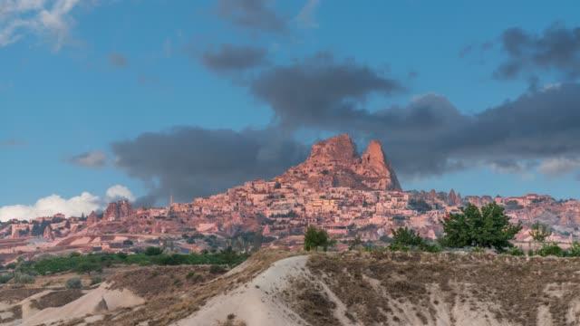 ortahisar cave city in cappadocia, turkey on sunset - castello video stock e b–roll