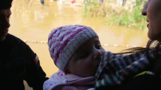 orthodox christian celebrate epiphany in the waters of the eastern bank of the jordan river on february 2 2018 in tal elkharrar jordan belived to be... - wallfahrt stock-videos und b-roll-filmmaterial