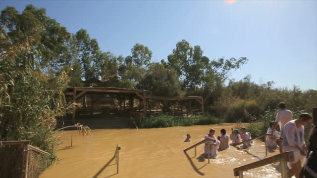 orthodox christian pilgrims baptised in jordan river - baptist stock videos & royalty-free footage