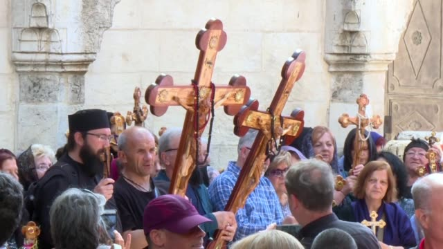 orthodox christians celebrate good friday in jerusalem by taking part in the procession of the way of the cross at the via dolorosa - easter stock videos & royalty-free footage