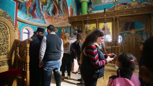 orthodox christians celebrate the epiphany inside the church of st john the baptist on february 2 2018 in tal elkharrar jordan every year christians... - wallfahrt stock-videos und b-roll-filmmaterial
