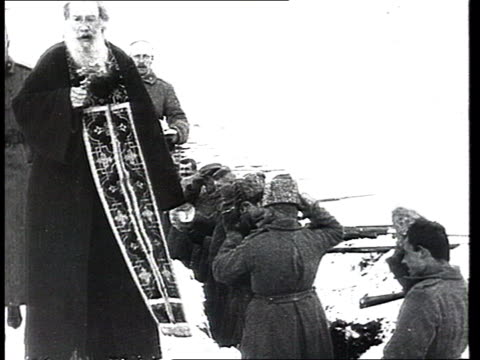orthodox church at the wwi front orthodox priests blessing russian army soldiers in trenches heavy guns and cannons firing troops of a russian army... - trench stock videos & royalty-free footage