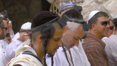 cu orthodox jews praying at wailing wall / jerusalem, israel - judaism stock videos & royalty-free footage