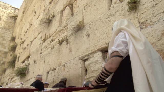 ms la pan orthodox jews praying at wailing wall / jerusalem, israel - judaism stock videos & royalty-free footage
