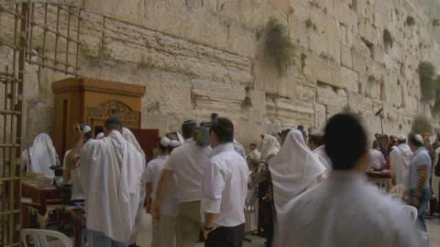 ws td orthodox jews praying at wailing wall / jerusalem, israel - skull cap stock videos & royalty-free footage