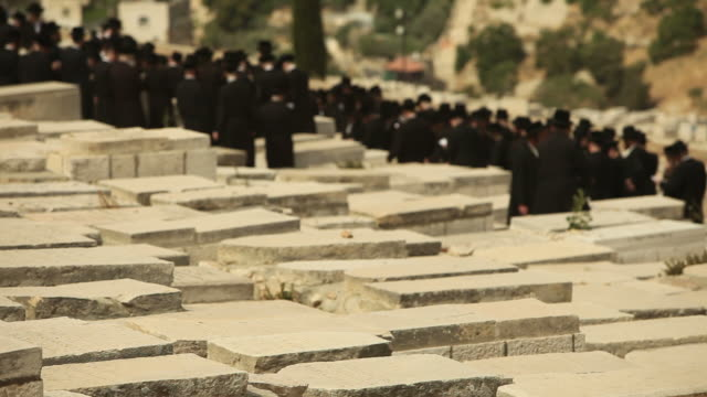 orthodox jews praying in a jerusalem cemetery - judaism stock videos & royalty-free footage