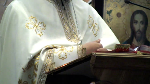 orthodox priest with during the sermon. - 僧衣点の映像素材/bロール