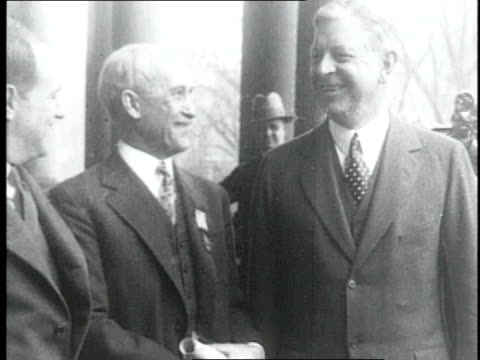 vídeos de stock, filmes e b-roll de orville wright receiving distinguished flying cross for the achievement at kitty hawk / united states - orville wright