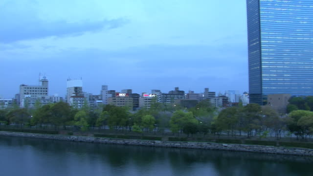 ws, pan, osaka business park by yodo river, osaka, japan - riverbank stock videos & royalty-free footage