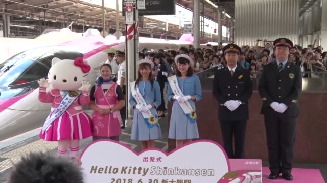 osaka japan june 30:a shinkansen bullet train featuring hello kitty livery starts services on june 30 with people observing the departure of the... - hello kitty stock videos and b-roll footage