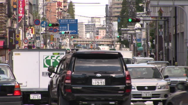 osaka, japanview of a city street in osaka japan - railroad car stock videos and b-roll footage
