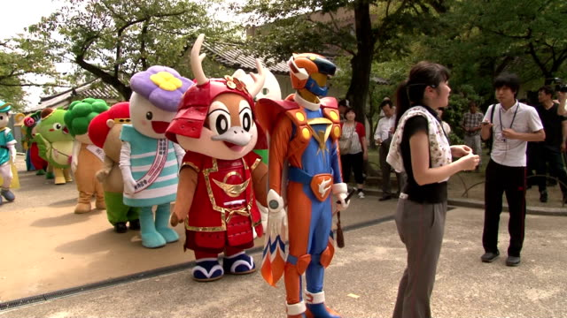 osaka prefecture's mascot character mozuyan, joined by mascots for the municipal government and prefectural police, 34 characters in total, gathered... - mascot stock videos & royalty-free footage