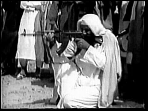 Osama Bin Laden and another testing rifles