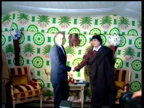 close up LIB Tony Blair MP shaking hands with General Moammar Gaddafi