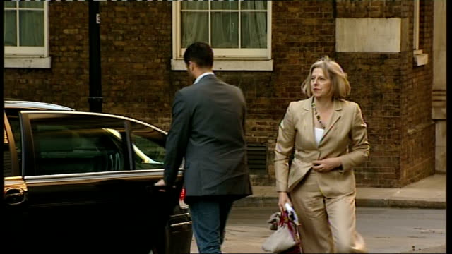 british embassies put on security alert downing street ext theresa may mp getting out of car on arrival for an emergency planning committee meeting... - emergency planning stock videos and b-roll footage