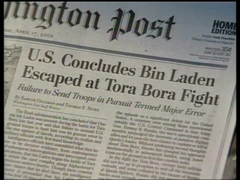 video/us force missed chance to capture itn cs washington post front page article saying that al qaida leader osama bin laden escaped capture during... - missed chance stock videos & royalty-free footage