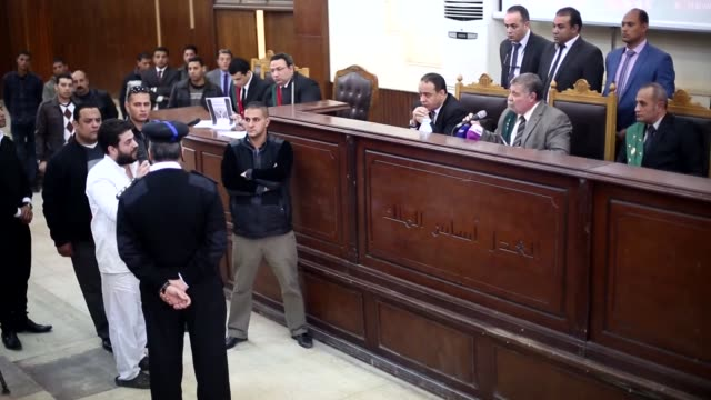 osama mohamed morsi and abdullah morsi the sons of ousted egyptian president mohamed morsi are seen during the trial over the breaking up the rabaa... - president of egypt stock videos & royalty-free footage