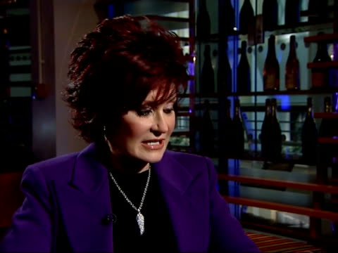 osbourne memorabilia auction at o2 arena: sharon osbourne photocall and interview; sharon osbourne interview sot - on why they are getting rid of... - manipolazione di colore video stock e b–roll