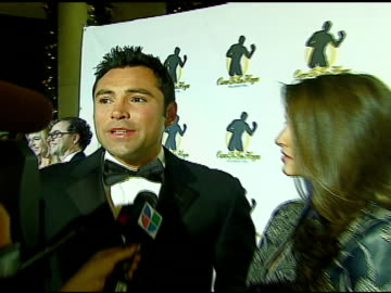 oscar de la hoya and millie corretjer at the 2006 evening of champions at the beverly hilton in beverly hills, california on december 6, 2006. - oscar de la hoya video stock e b–roll