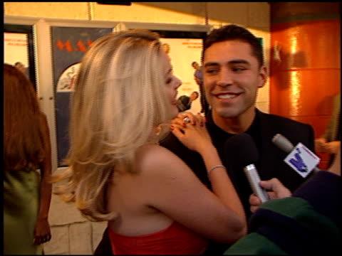 oscar de la hoya at the 'love stinks' premiere at the mann village theatre in westwood, california on august 11, 1999. - oscar de la hoya stock videos & royalty-free footage