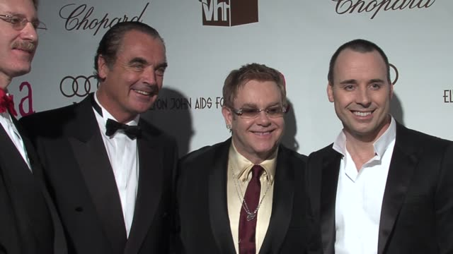 oscar party guests with sir elton john and david furnish at the 14th annual elton john aids foundation oscar party co-hosted by audi, chopard and vh1... - oscar party stock videos & royalty-free footage