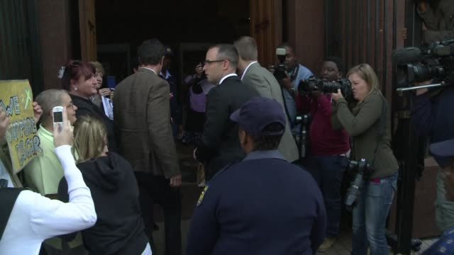 oscar pistorius arrived in court monday as his murder trial resumes after a two week break with the defence expected to call another round of expert... - legal defense stock videos & royalty-free footage