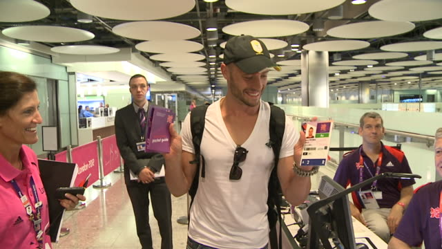 oscar pistorius displays his registration documents after arriving at heathrow for the london olympics - ピストリウス恋人射殺事件点の映像素材/bロール