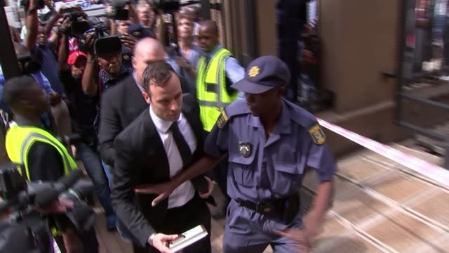 oscar pistorius granted bail over murder conviction south africa pretoria ext oscar pistorius arriving at court for bail hearing with press around... - court hearing stock videos and b-roll footage