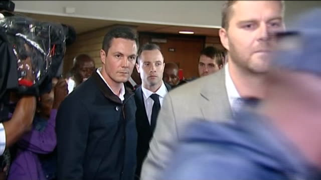 oscar pistorius murder trial day 3 oscar pistorius leaving courtroom surrounded by security with press shouting questions - murder stock videos & royalty-free footage