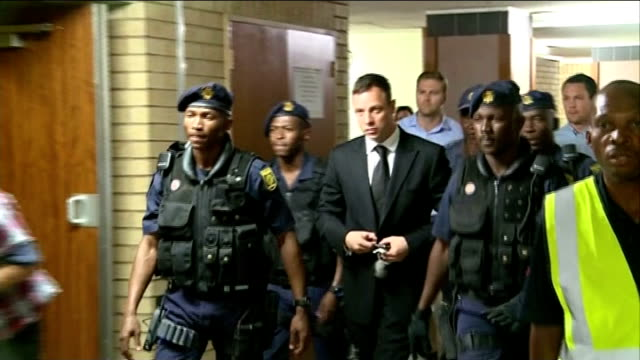 oscar pistorius sentenced to five years; int ** flash photography ** pistorius arriving at court with police escort - 後を追う点の映像素材/bロール