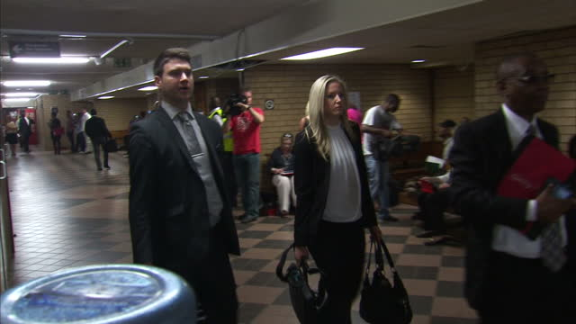 oscar pistorius to be sentenced today shows interior shots roxanne adams walking through courthouse on october 21 2014 in pretoria south africa - ピストリウス恋人射殺事件点の映像素材/bロール