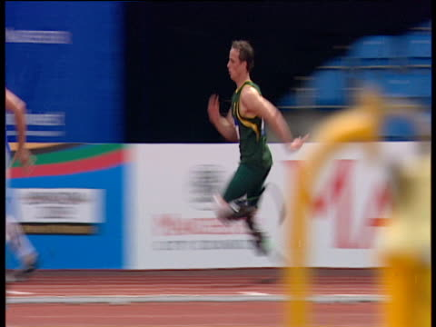 oscar pistorius wins men's t44 200m final in world record time of 2201 paralympic world cup manchester 2005 - world record stock videos & royalty-free footage