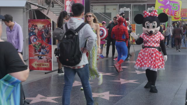 oscar preparation is underway, it draws tourists to hollywood boulevard, kodak theater, hollywood sign, and the hollywood walk of fame. - viale video stock e b–roll