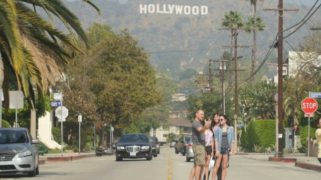 stockvideo's en b-roll-footage met oscar preparation is underway it draws tourists to hollywood boulevard hollywood sign and the hollywood walk of fame - boulevard
