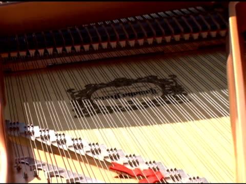 A Oscar Sneek Peek at the Yamaha Elton John Limited Edition Series Red Piano Worth $80000 at the Unveiling of the Yamaha Elton John Limited Edition...