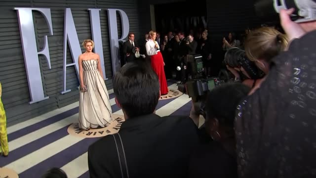 Vanity Fair Afterparty red carpet interviews Allison Janney along with Oscar / Greta Gerwig along in white dress / people along / Greta Gerwig posing...