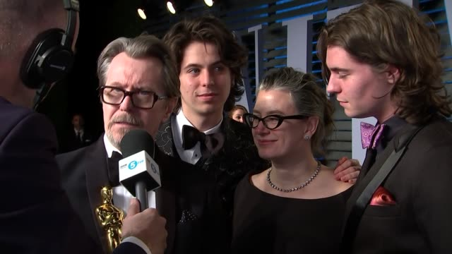 Vanity Fair Afterparty red carpet interviews Gary Oldman along with Gisele Schmidt and Gulliver Oldman Gary Oldman interview SOT Close shots Gary...