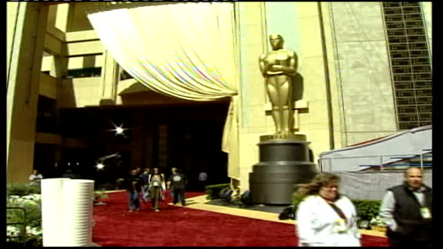 Oscars ceremony 2006 ***Music overlaid Los Angeles Hollywood Kodak Theatre General view of Oscar statues wrapped up on red carpet on morning of...